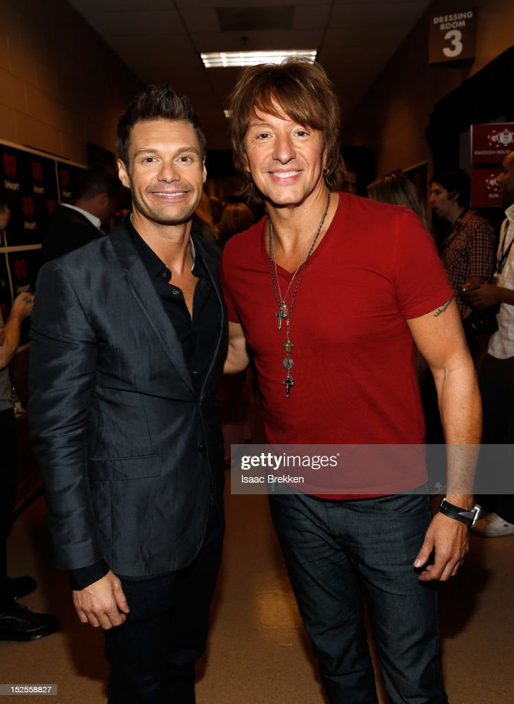 Host <a gi-track='captionPersonalityLinkClicked' href=/galleries/search?phrase=Ryan+Seacrest&family=editorial&specificpeople=201694 ng-click='$event.stopPropagation()'>Ryan Seacrest</a> (L) and guitarist <a gi-track='captionPersonalityLinkClicked' href=/galleries/search?phrase=Richie+Sambora&family=editorial&specificpeople=204195 ng-click='$event.stopPropagation()'>Richie Sambora</a> of Bon Jovi appear backstage during the 2012 iHeartRadio Music Festival at the MGM Grand Garden Arena on September 21, 2012 in Las Vegas, Nevada.