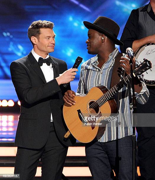 Host Ryan Seacrest and musician CJ Harris onstage during Fox's 'American Idol' XIII Finale at Nokia Theatre LA Live on May 21 2014 in Los Angeles...
