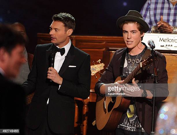 Host Ryan Seacrest and musician Sam Woolf perform onstage during Fox's 'American Idol' XIII Finale at Nokia Theatre LA Live on May 21 2014 in Los...