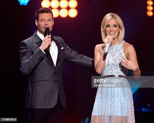 Host Ryan Seacrest and recording artist Carrie Underwood speak onstage during FOX's 'American Idol' Finale For The Farewell Season at Dolby Theatre...