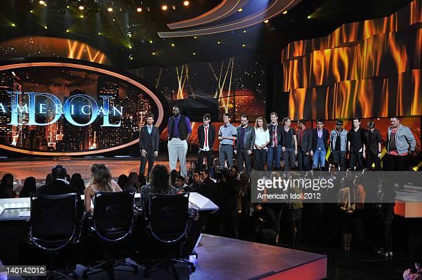 Host Ryan Seacrest and the top 13 guy contestants Reed Grimm Adam Brock DeAndre Brackensick Colton Dixon Jeremy Rosado Aaron Marcellus Chase Likens...