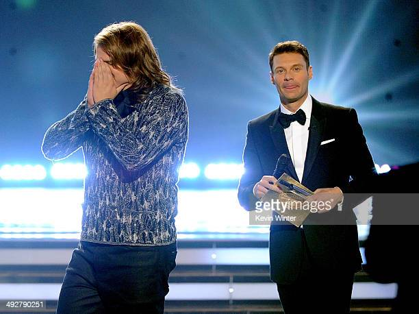 Host Ryan Seacrest announces Caleb Johnson as the winner onstage during Fox's 'American Idol' XIII Finale at Nokia Theatre LA Live on May 21 2014 in...
