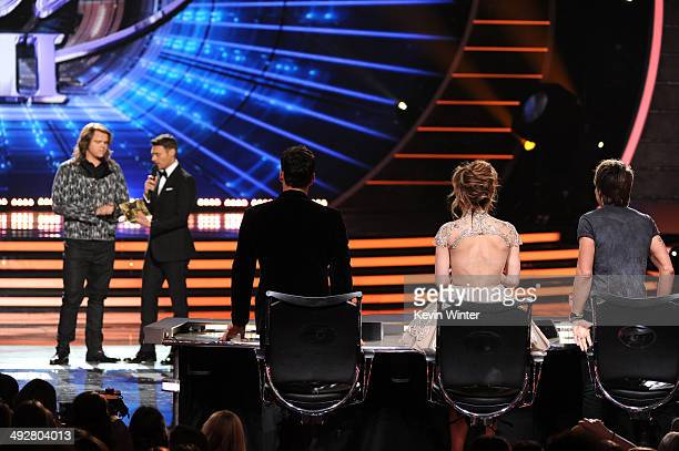 Host Ryan Seacrest announces Caleb Johnson as the winner with American Idol Judges Harry Connick Jr Jennifer Lopez and Keith Urban onstage during...