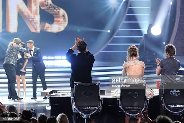 Host Ryan Seacrest announces Caleb Johnson as the winner with American Idol Finalist Jena Irene and American Idol Judges Harry Connick Jr Jennifer...