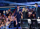 Host Ryan Seacrest guest judge and Season 1 winner Kelly Clarkson and judge Harry Connick Jr onstage at FOX's American Idol Season 15 on February 25...