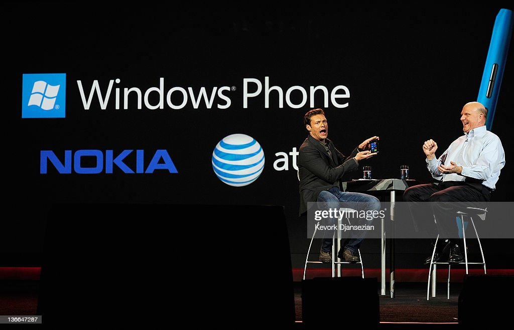 Host <a gi-track='captionPersonalityLinkClicked' href=/galleries/search?phrase=Ryan+Seacrest&family=editorial&specificpeople=201694 ng-click='$event.stopPropagation()'>Ryan Seacrest</a> (L) holds the new Nokia Lumia 900 windows phone during a Microsoft CEO <a gi-track='captionPersonalityLinkClicked' href=/galleries/search?phrase=Steve+Ballmer&family=editorial&specificpeople=211258 ng-click='$event.stopPropagation()'>Steve Ballmer</a>'s keynote address at the 2012 International Consumer Electronics Show at The Venetian January 9, 2012 in Las Vegas, Nevada. CES, the world's largest annual consumer technology trade show, runs through January 13 and is expected to feature 2,700 exhibitors showing off their latest products and services to about 140,000 attendees.