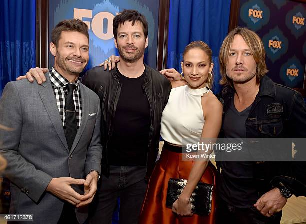 Host Ryan Seacrest judges musician Harry Connick Jr singer Jennifer Lopez and musician Keith Urban of American Idol pose at the Fox Winter TCA...