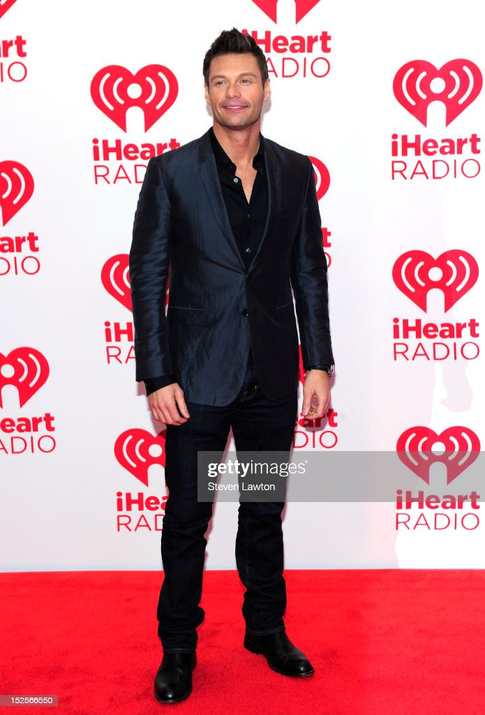 Host <a gi-track='captionPersonalityLinkClicked' href=/galleries/search?phrase=Ryan+Seacrest&family=editorial&specificpeople=201694 ng-click='$event.stopPropagation()'>Ryan Seacrest</a> poses in the press room at the iHeartRadio Music Festival at the MGM Grand Garden Arena September 21, 2012 in Las Vegas, Nevada.