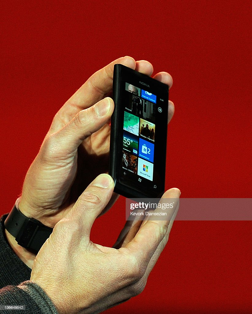 Host <a gi-track='captionPersonalityLinkClicked' href=/galleries/search?phrase=Ryan+Seacrest&family=editorial&specificpeople=201694 ng-click='$event.stopPropagation()'>Ryan Seacrest</a> show displays the new Nokia Lumia 900 Windows phone as Microsoft CEO <a gi-track='captionPersonalityLinkClicked' href=/galleries/search?phrase=Steve+Ballmer&family=editorial&specificpeople=211258 ng-click='$event.stopPropagation()'>Steve Ballmer</a> delivers a keynote address at the 2012 International Consumer Electronics Show at The Venetian January 09, 2012 in Las Vegas, Nevada. CES, the world's largest annual consumer technology trade show, runs through January 13 and is expected to feature 2,700 exhibitors showing off their latest products and services to about 140,000 attendees.