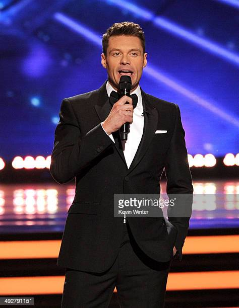 Host Ryan Seacrest speaks onstage during Fox's 'American Idol' XIII Finale at Nokia Theatre LA Live on May 21 2014 in Los Angeles California