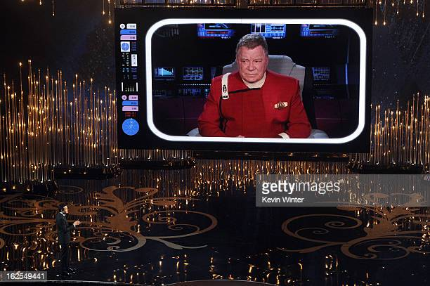 Host Seth MacFarlane talks to actor William Shatner on the video screen during the Oscars held at the Dolby Theatre on February 24 2013 in Hollywood...