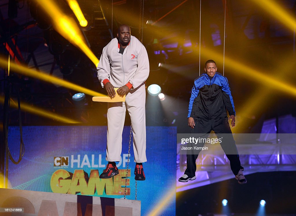 Host Shaquille O'Neal and co-host Nick Cannon look on suspended in the air above the stage at the Third Annual Hall of Game Awards hosted by Cartoon Network at Barker Hangar on February 9, 2013 in Santa Monica, California. 23270_003_JK_0297.JPG