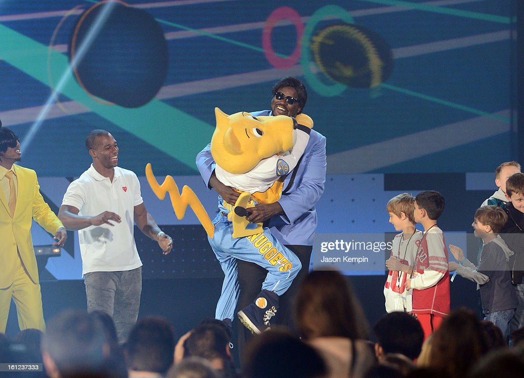 Host Shaquille O'Neal hugs Denver Nuggets/NBA mascot Rocky onstage at the Third Annual Hall of Game Awards hosted by Cartoon Network at Barker Hangar on February 9, 2013 in Santa Monica, California. 23270_003_JK_0794.JPG