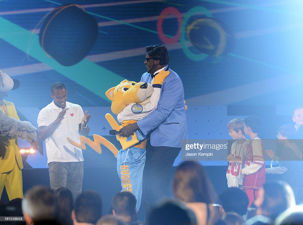 Host Shaquille O'Neal hugs Denver Nuggets/NBA mascot Rocky onstage at the Third Annual Hall of Game Awards hosted by Cartoon Network at Barker Hangar on February 9, 2013 in Santa Monica, California. 23270_003_JK_0798.JPG