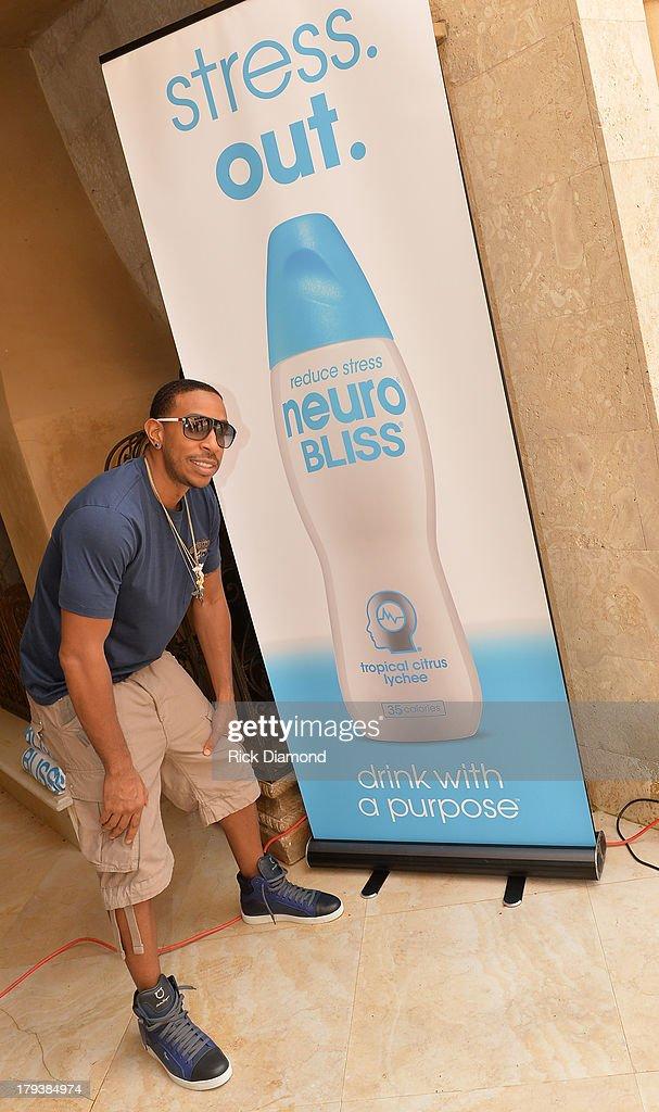 Host Singer/Songwriter/Actor Ludacris during Neuro Drinks At LudaDay Weekend Celebrity Pool Party on September 2, 2013 in Atlanta, Georgia.