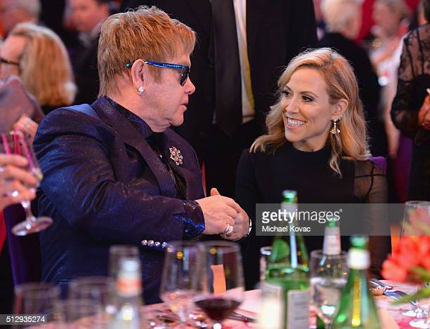 Host Sir Elton John and singersongwriter Sheryl Crow attend the 24th Annual Elton John AIDS Foundation's Oscar Viewing Party at The City of West...