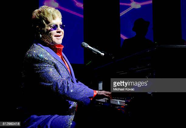 Host Sir Elton John performs onstage during the 24th Annual Elton John AIDS Foundation's Oscar Viewing Party at The City of West Hollywood Park on...
