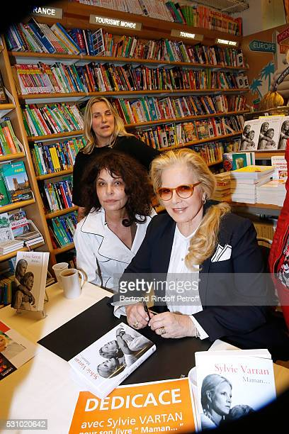 TV host Sophie Favier actress Isabelle Mergault and singer Sylvie Vartan attend Sylvie Vartan signs her Book 'Maman' at Librairie Lamartine on May 12...