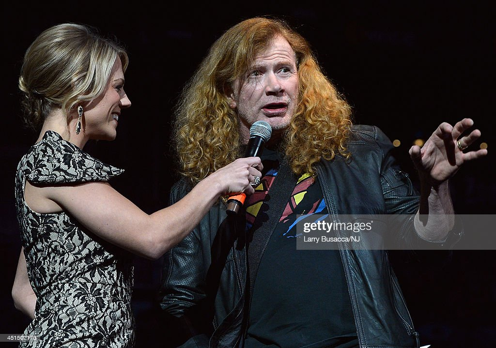 host Stacy McCloud introduces Megadeth's Dave Mustaine during Playin' Possum! The Final No Show Tribute To George Jones - Show at Bridgestone Arena on November 22, 2013 in Nashville, Tennessee.