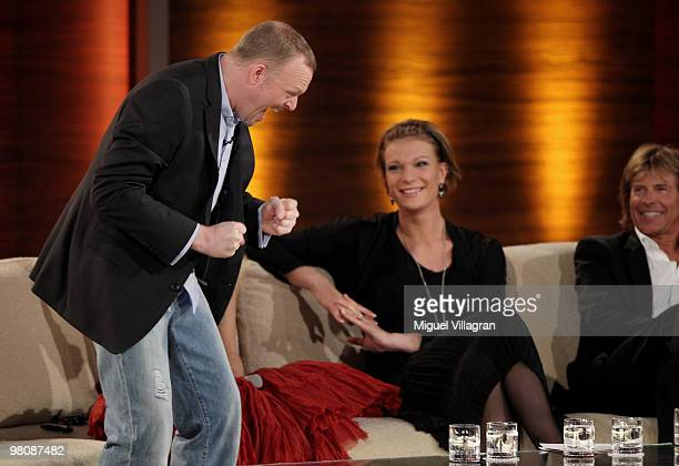 TV host Stefan Raab reacts next to Shakira Maria Riesch and Hansi Hinterseer during the 188th 'Wetten dass ' show at Messezentrum Salzburg on March...
