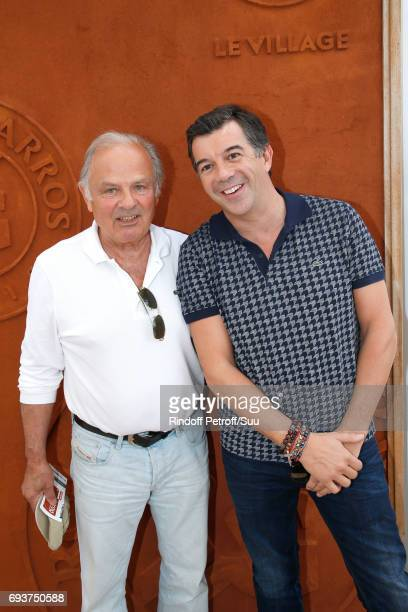 Host Stephane Plaza and his stepfather Patrick Paradon attend the 2017 French Tennis Open Day Twelve at Roland Garros on June 8 2017 in Paris France