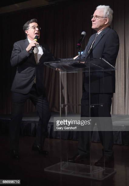Host Stephen Colbert and Steve Martin perform on stage during the Elevator Repair Service Theater 25th Anniversary gala at Tribeca Rooftop on May 22...
