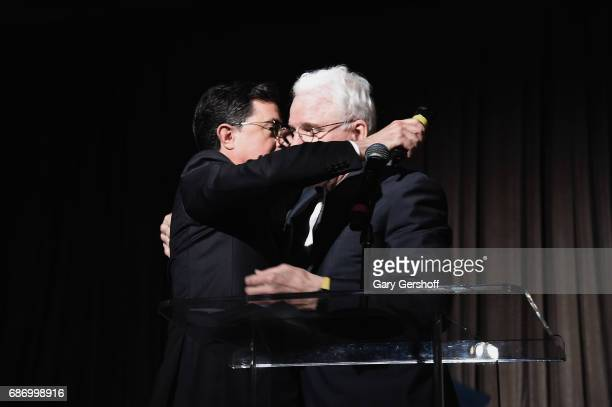 Host Stephen Colbert and Steve Martin seen on stage during the Elevator Repair Service Theater 25th Anniversary gala at Tribeca Rooftop on May 22...