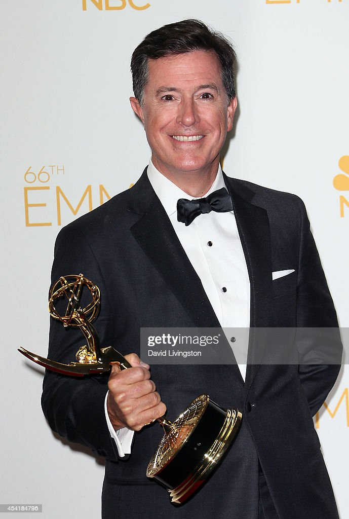 TV host <a gi-track='captionPersonalityLinkClicked' href=/galleries/search?phrase=Stephen+Colbert&family=editorial&specificpeople=215133 ng-click='$event.stopPropagation()'>Stephen Colbert</a> poses in the press room at the 66th Annual Primetime Emmy Awards at the Nokia Theatre L.A. Live on August 25, 2014 in Los Angeles, California.