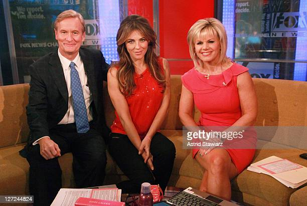 Host Steve Doocy actress Elizabeth Hurley and host Gretchen Carlson tape an episode of 'FOX Friends'at FOX Studios on September 27 2011 in New York...