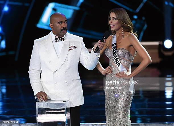 Host Steve Harvey listens as Miss Colombia 2015 Ariadna Gutierrez Arevalo answers a question during the interview portion of the 2015 Miss Universe...