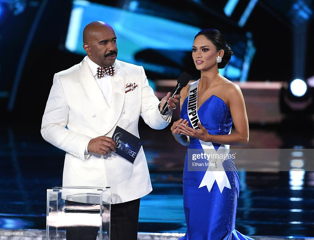 Host Steve Harvey (L) listens as Miss Philippines 2015, Pia Alonzo Wurtzbach, answers a question during the interview portion of the 2015 Miss Universe Pageant at The Axis at Planet Hollywood Resort & Casino on December 20, 2015 in Las Vegas, Nevada. Wurtzbach went on to be crowned the new Miss Universe.