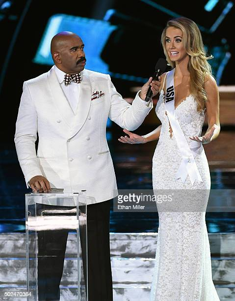 Host Steve Harvey listens as Miss USA 2015 Olivia Jordan answers a question during the interview portion of the 2015 Miss Universe Pageant at The...