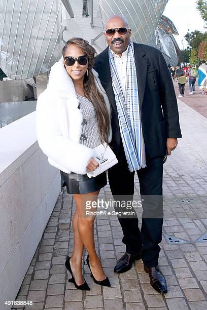 Host Steve Harvey with his wife Marjorie attend the Louis Vuitton show as part of the Paris Fashion Week Womenswear Spring/Summer 2016 Held at...