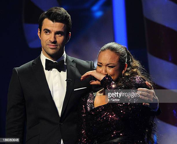Host Steve Jones and Top 3 finalist Melanie Amaro onstage at FOX's 'The X Factor' Live Finale Show on December 22 2011 in Hollywood California THE X...