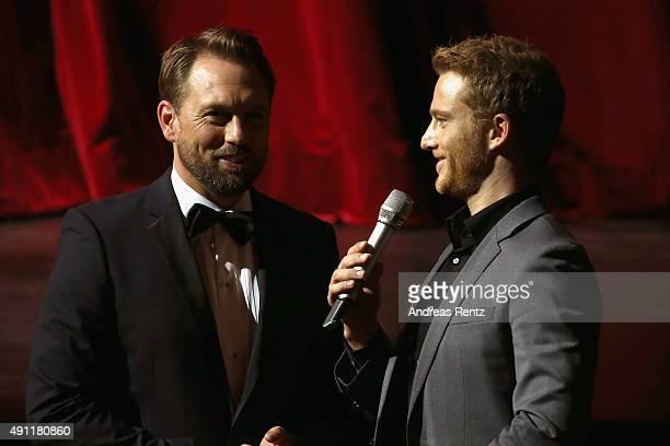 Host Steven Gaetjen and actor Alexander Fehling speak onstage at the Award Night during the Zurich Film Festival on October 3 2015 in Zurich...