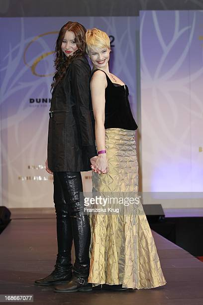 Host Susann Atwell And Daughter Emma modeling for a good cause at The Event Prominent fashion show at the Grand Elysée in Hamburg
