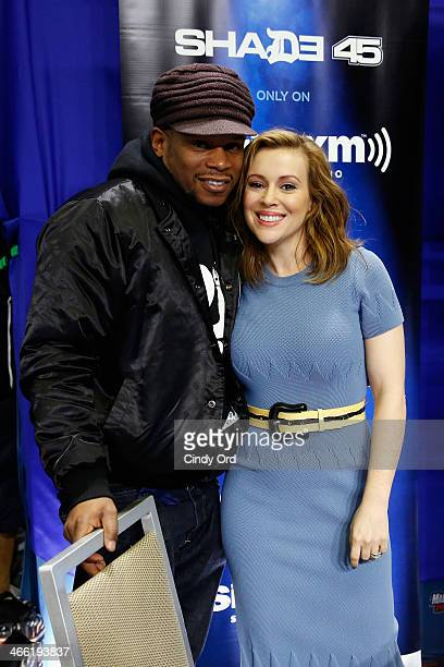 Host Sway Calloway and actress Alyssa Milano attend SiriusXM's Shade 45 at Super Bowl XLVIII Radio Row on January 31 2014 in New York City