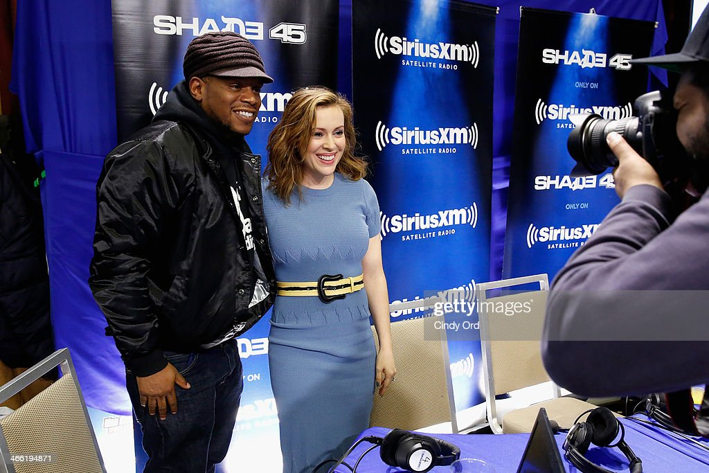 Host Sway Calloway (L) and actress Alyssa Milano attend SiriusXM's Shade 45 at Super Bowl XLVIII Radio Row on January 31, 2014 in New York City.