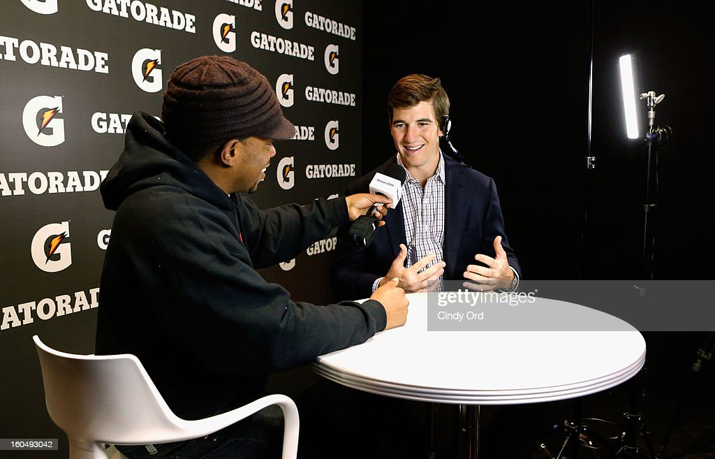 Host Sway Calloway and NFL Player Eli Manning attend SiriusXM's Shade 45 channel during the live broadcast from Radio Row during Bowl XLVII week on February 1, 2013 in New Orleans, Louisiana.