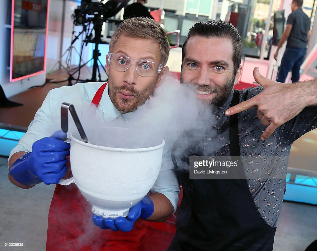 Host Tanner Thomason (L) and Chef Marcel Vigneron pose at Hollywood Today Live at W Hollywood on June 27, 2016 in Hollywood, California.