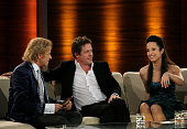 Host Thomas Gottschalk talks to Hugh Grant and Stephanie Stumph during the Wetten dass show at the AWD Dome on December 5 2009 in Bremen Germany