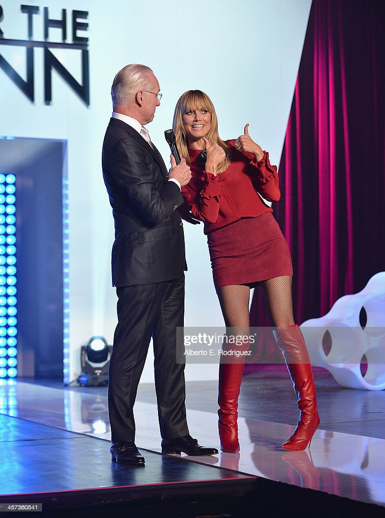 TV host <a gi-track='captionPersonalityLinkClicked' href=/galleries/search?phrase=Tim+Gunn&family=editorial&specificpeople=696109 ng-click='$event.stopPropagation()'>Tim Gunn</a> and model <a gi-track='captionPersonalityLinkClicked' href=/galleries/search?phrase=Heidi+Klum&family=editorial&specificpeople=178954 ng-click='$event.stopPropagation()'>Heidi Klum</a> attends the 'Under The Gunn' Finale Fashion Show at Los Angeles Theatre on December 16, 2013 in Los Angeles, California.