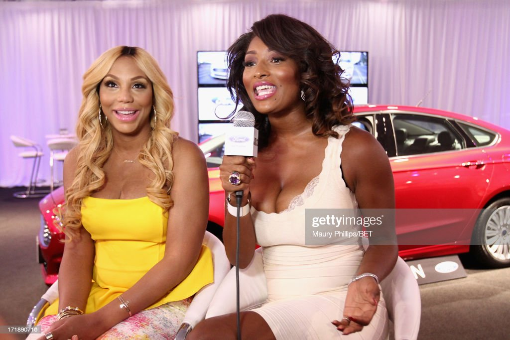 Host <a gi-track='captionPersonalityLinkClicked' href=/galleries/search?phrase=Toccara+Jones&family=editorial&specificpeople=2253497 ng-click='$event.stopPropagation()'>Toccara Jones</a> (R) and recording artist Tamar attend Hot Spot Room Day 2 during the 2013 BET Awards at L.A. LIVE on June 29, 2013 in Los Angeles, California.