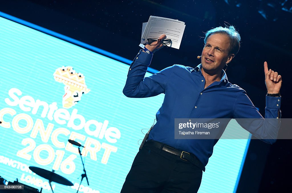 Host <a gi-track='captionPersonalityLinkClicked' href=/galleries/search?phrase=Tom+Bradby&family=editorial&specificpeople=7079382 ng-click='$event.stopPropagation()'>Tom Bradby</a> appears on stage during the Sentebale Concert at Kensington Palace on June 28, 2016 in London, England. Sentebale was founded by Prince Harry and Prince Seeiso of Lesotho over ten years ago. It helps the vulnerable and HIV positive children of Lesotho and Botswana.