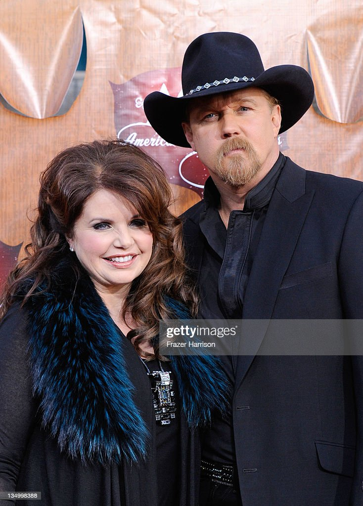 Host <a gi-track='captionPersonalityLinkClicked' href=/galleries/search?phrase=Trace+Adkins&family=editorial&specificpeople=224686 ng-click='$event.stopPropagation()'>Trace Adkins</a> (R) and Rhonda Forlaw arrive at the American Country Awards 2011 at the MGM Grand Garden Arena on December 5, 2011 in Las Vegas, Nevada.