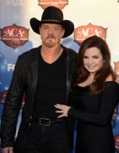 Host Trace Adkins and wife Rhonda Forlaw arrive at the American Country Awards 2013 at the Mandalay Bay Events Center on December 10 2013 in Las...