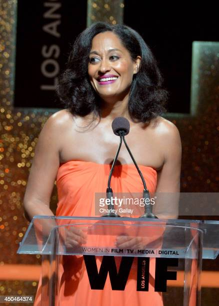 Host Tracee Ellis Ross speaks onstage at Women In Film 2014 Crystal Lucy Awards presented by MaxMara BMW PerrierJouet and South Coast Plaza held at...