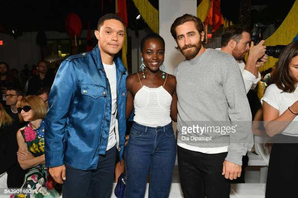 Host Trevor Noah and actors Lupita Nyong'o and Jake Gyllenhaal attend the Calvin Klein Collection fashion show during New York Fashion Week on...
