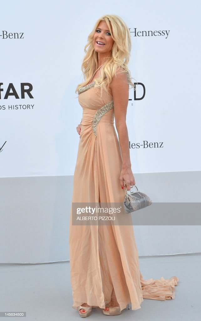 TV host Victoria Silvstedt poses as she arrives to attend the 2012 amfAR's Cinema Against Aids on May 24, 2012 in Antibes, southeastern France. AFP PHOTO / ALBERTO PIZZOLI