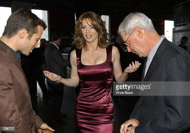 Host Wendy Walsh talks with correspondent AJ Hammer and Court TV president Henry Schlief at celebration of the oneyear anniversary of the cable...